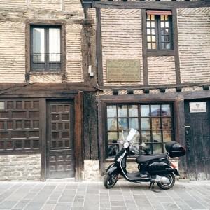 Old meets new - cute little moped outside a building…